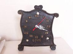 Peace and love clocks. Original design cast in bronze.