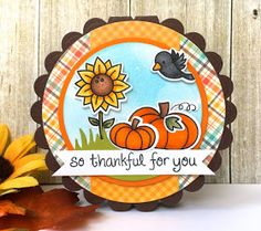 LF Happy HarvestandSo Thankful, Grassy Hillside Borders, Perfectly Plaid paper. Images colored w Copics. Card base is the scalloped circle die overlapping the edge of the die over the fold of chocolate chip cardstock before cutting. Die cut a circle w Perfectly Plaid LF paper and a strip of ginghamDoodlebug Design paperdown the center.