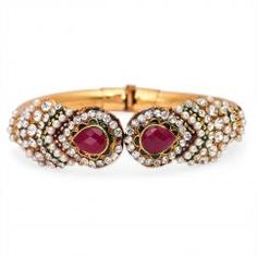 http://crazyberry.in/online-shopping/artificial-imitation-fashion-jewellery/traditional-rajasthani-emerald-pearl-bangle