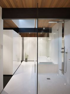 Clean, open and #modern #bathroom with wood ceiling design and straight lines. Walk in shower