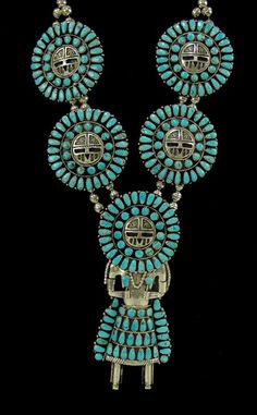 Necklace | Larry Moses Begay (Navajo).  Large kachina pendant and four matching kachina head medallions.  Sterling silver and turquoise.  ca. 1980s