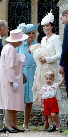 All smiles: The Queen and the Duke of Edinburgh chat to Kate, William and Camilla after th...