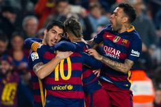 Luis Suarez (L) of FC Barcelona celebrates with his teammates Lionel Messi (2nd L), Neymar Santos Jr (2nd R)) and Dani Alves (R) after scoring his team's first goal during the Copa del Rey Quarter Final Second Leg between FC Barcelona and Athletic Club at Camp Nou stadium on January 27, 2016 in Barcelona