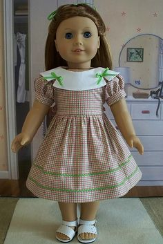 Emily Bennett Hairstyle: *shoulder length* half ponytail Footwear: scalloped sandals Outfit: checkered dress with rick-rack Fabric: Cotton Color: pink and light green Circa: 1940s  Used For: parties