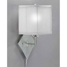 Brighten your home decor with a pin-up plug-in lampWall lamp features a stylish white corduroy shadeLighting fixture is the perfect touch to any room
