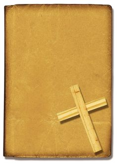 A paper Bible cover with a Christian cross.
