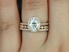 This wedding set is designed for those who love simple and the classics. The wedding band will sit flush against this engagement ring.    All stones