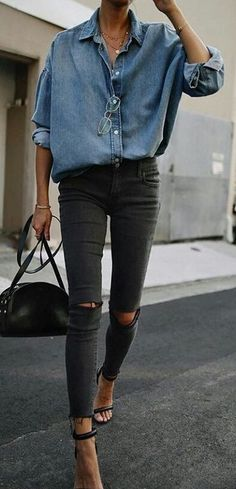 #spring #outfits blue denim coat and black fitted jeans holding black while walking. Pic by @streetstyle__outfits