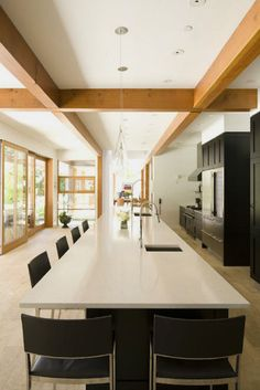 By Burgers Architecture in Vancouver. The lines in this kitchen make the space what it is.