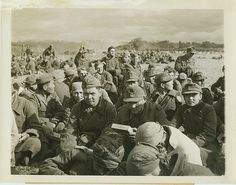 """New York Bureau.Captured with Nazis.France - Visible among the faces of these men, captured by the Allied liberation forces in Normandy, are Chinese and Mongolian types. Reports from Allied Headquarters indicate that Japanese also were among those fighting for the Nazis. At least, these men, (above), seem happy that they no longer have to fight for the German """"Super Race."""" Passed by censors..Credit: Acme photo by Bert Brandt for War Picture Pool.Date: 6-15-44"""