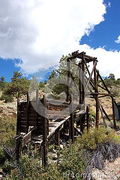 Photo about An old abandoned wooden mining structure sitting outside an old gold mine in the mountains of Colorado. Image of outside, hill, colorado - 79425666 State Of Colorado, Gold Mine, Beautiful Landscapes, Abandoned, The Outsiders, Stock Photos, Mountains, House Styles, Wood