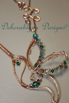 Deborahlynn Designs ® ~ Wired Wings Hummingbird ~ Suncatchers...dainty bejeweled exquisite hummingbirds!  The wee hummers drink nectar from a delicate flower and are beautifully adorned with stunning swarovski crystals and a crystal prism ...GoRgEoUs!  To order a custom design,   email rhythmnbeads@gmail.com  WIRED WINGS HUMMERS are a NEW & original sunjewel design by Deborahlynn Designs®