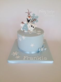 Frozen theme birthday cake with Olaf and snowflakes topper