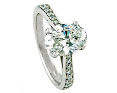 Solitaire engagement ring with oval shaped centre diamond set in 18k white gold
