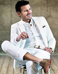 Tips for the rare all white outfit: 1) Needs to fit well, 2) No khaki, 3) No socks, 4) Small bits of color to accent the outfit--notice how effectively the shoes and pocket square break up the monochrome.