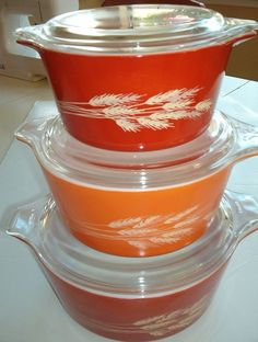 Vintage Pyrex casserole dishes - In ORANGE! with sheaf of wheat on it! I think April has these 3 now.