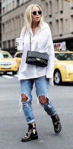 white blouse. ripped boyfriend jeans. buckle ankle boots. street style.