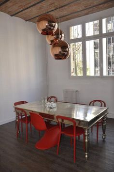 Kitchen Studio in Paris. The copper lighting and the metallic table are a great contrast. I hope my table comes out like this!!!