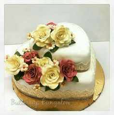 Chocolate truffle and rainbow cake tiers decorated with Fondant roses.