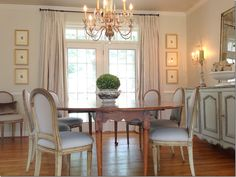 """pretty table, chairs, chandelier and buffet. great idea to buy large, cheap shells and """"weather"""" them outside to give them some age and authenticity"""