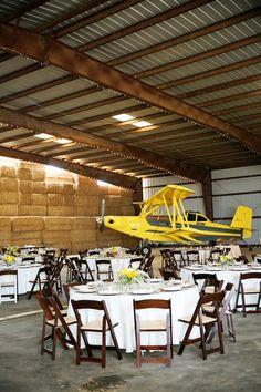 Ruffled - photo by http://www.sarahtamagniphoto.com/ - http://ruffledblog.com/stormy-day-plane-hangar-wedding | Ruffled