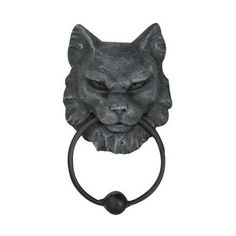 "For cat lovers everywhere we bring you this door knocker with a fierce and stern looking cat head holding the knocker. Knock if you dare! Cold cast resin. 7"" x 4 1/2"" x 2"""