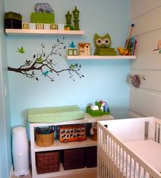 Cute storage space for Owl Nursery and cute way to keep it simple, and nice in a small space