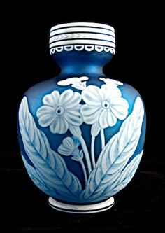 A dramaticThomas Webb Cameo glass vase with Primula design and a moth on the reverse side.
