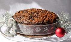 This is a simple and easy Christmas cake to make. Boiling the fruit makes it plump and juicy. The end result is a brandied moist fruit cake that makes a great gift. It also looks wonderful as a centrepiece on your Christmas table.