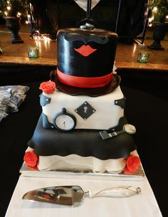"""""""A Victorian Cabaret""""   3 tiers of red velvet cake decorated with fondant and gum paste. For the wedding of Mr. and Mrs. Windsor."""