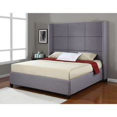 This grey polyester-upholstered king-size bed will add elegance and sophistication to any bedroom. The modern headboard features a cubed upholstered motif. The sturdy slats, solid rubber wood frame, and side rails make this bed durable.