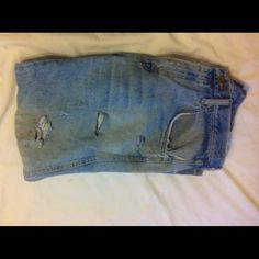 Distresed Jeans Trendy  distressed Jeans faded blue color. 2front pockets And 2 back pockets zipper And button in exellent condition. Jeans