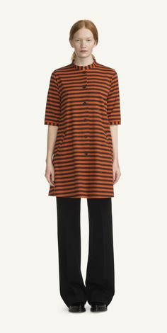 """MARIMEKKO KASTE DRESS - HEATHER GREY, ORANGE  You could say it's a morning, an afternoon, and an evening dress. The Tasaraita stripes and weighted cotton are ready for wherever you need to go; wear it open with shirt and skinny jeans, or button it up for a charming A-line dress. Kaste measures 31"""" long, and has three-quarter length gathered sleeves.  #pirkkoseattle #pirkkofinland #orange #stripes #preppy #aline #halloween"""