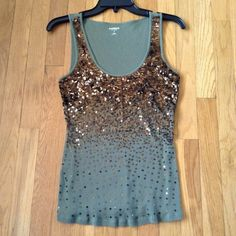Brown and green tank Sexy green tank top with brown sparkles on it !!! Snag this cute express tank top. Size medium. Good condition Express Tops Tank Tops