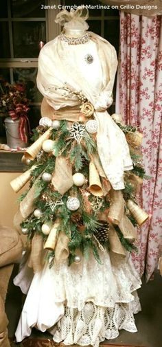 paper scrolls added to mannequin tree dress by Janet Martinez / www.grillo-designs.com