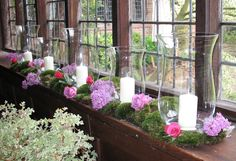 the windowsills at Ramster Hall decorated with moss, roses and candles