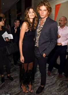 Model behaviour: Jordan Barrett posed up a storm with Cindy Crawford's model daughter Kaia Gerber at the Fashion Media Awards in New York on Thursday
