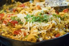migas--a scrambled egg dish loaded with onions, tomatoes, peppers, and cheese, and crisp corn tortilla pieces.
