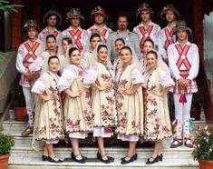 "Romanian women wearing ""Suman"", traditional Romanian coat worn during autumn (behind them are Calusari dancers)"