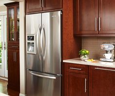Giallo ornamental granite countertops add elegance in the for Chocolate kitchen cabinets with stainless steel appliances