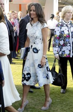 Pippa Middleton wore a white dress with a flower motif and lace top to the Coronation Festival Evening Gala event.