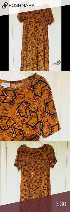 LulaRoe Carly Tribal print LulaRoe Carly. This dress is super comfy and such a fun print. Burnt orange with outline of arrows in black and small design in white, orange and deep red. Excellent condition. LuLaRoe Dresses