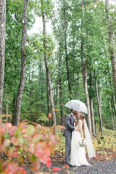 ShenandoahValley Bride and Groom Wedding Photos in the Rain with Umbrella by Katelyn James Photography