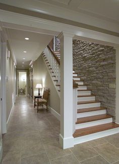 Love the stone wall down the basement stairs...Exactly what I want for my wall leading down into basement with stairs and rock wall as part of our new upstairs living space:)