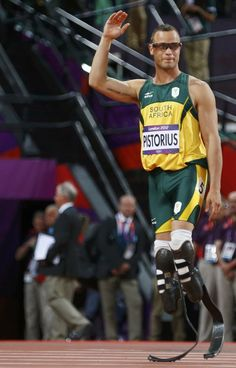 South Africa's Oscar Pistorius waves as he walks onto the track to compete in the men's 400m semi-final during the London 2012 Olympic Games at the Olympic Stadium August 5, 2012.