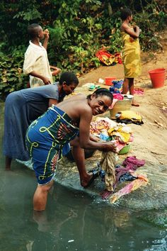 Washing cloths with a big smile . Gabon