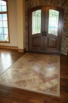 Great looking tile entry way, with granite accents, granite border ...