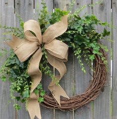 This beautiful burlap greenery wreath is the perfect simple accent for your door or interior. A wired burlap ribbon makes a simple bow. Average