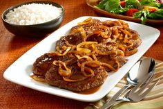 Bistec Encebollado, or steak and onions, is a spiced, flavorful skillet steak prepared with a classic Adobo-garlic rub. Bistec Encebollado takes its delicious flavor from our homemade marinade, made quickly and easily using GOYA. Bistec Encebollado Recipe, Bistec Recipe, Onion Recipes, Meat Recipes, Cooking Recipes, Healthy Recipes, Goya Recipes Puerto Rico, Steak And Onions, Comida Boricua