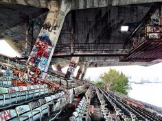 An abandoned water sports stadium that has become a haven for graffiti and decay